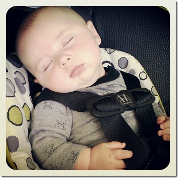 sleeping baby in carseat