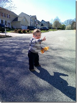 baby pointing at airplane