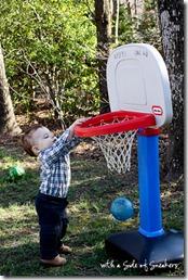 toddler playing basketball